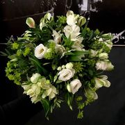 Round white and green funeralbouquet