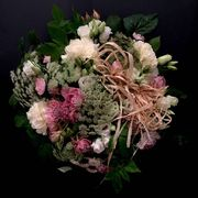Round pastel colored funeralbouquet
