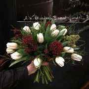 White tulips with red  skimmia