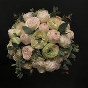 White and light pink weddingbouquet made of roses