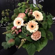 Round peach colored funeralbouquet
