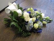 White and blue funeralbouquet