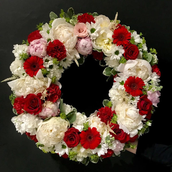 Red and white funeral wreath 1