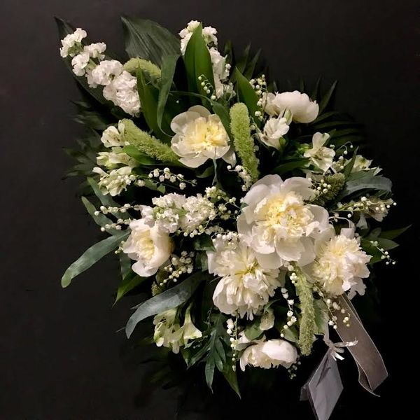White funeraldecoration with peonies