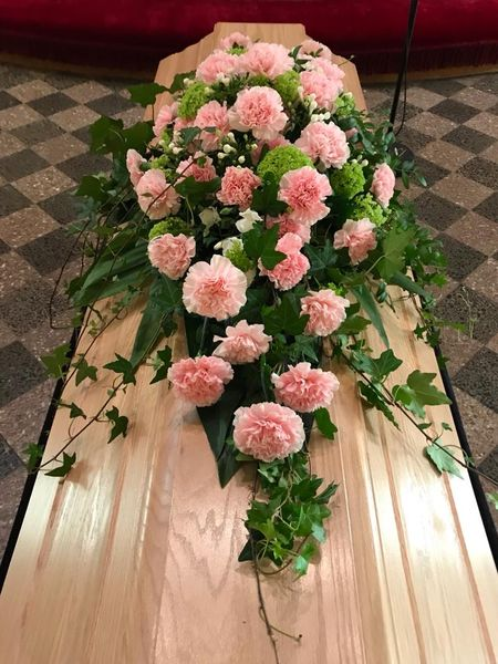 Funeral arrangment for coffin made of pink carnations