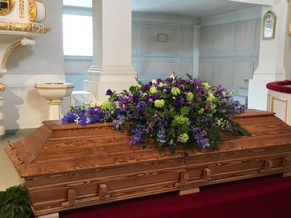 Funeral arrangment for coffin made of lilac and blue flowers