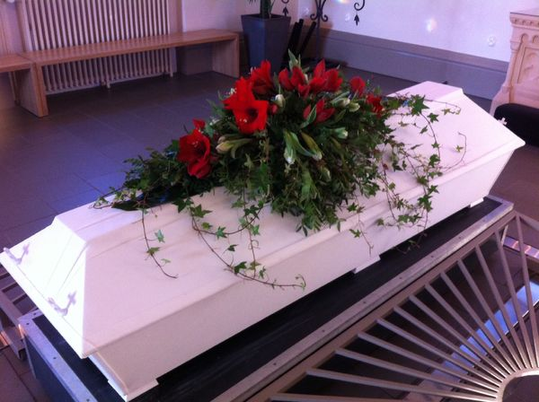 Funeral arrangment for coffin made of tulips and amaryllis