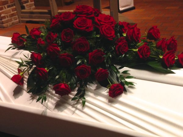 Funeral arrangment for coffin made of red roses