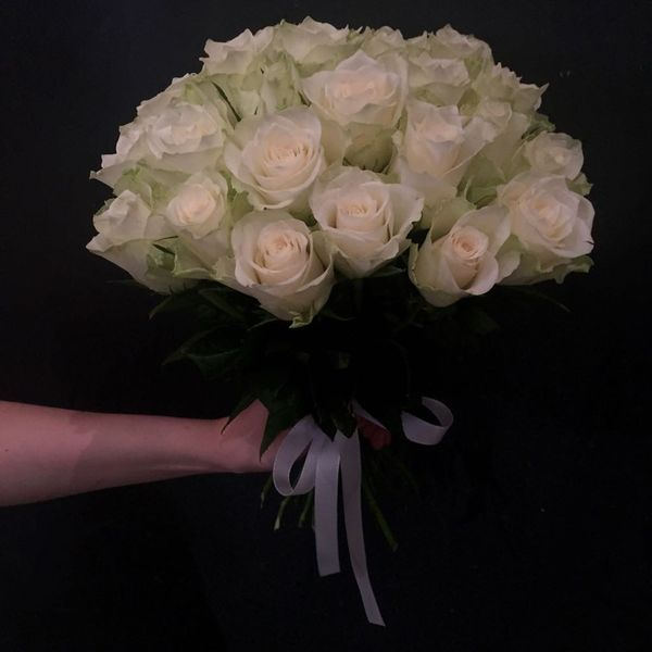High weddingbouquet made of white roses