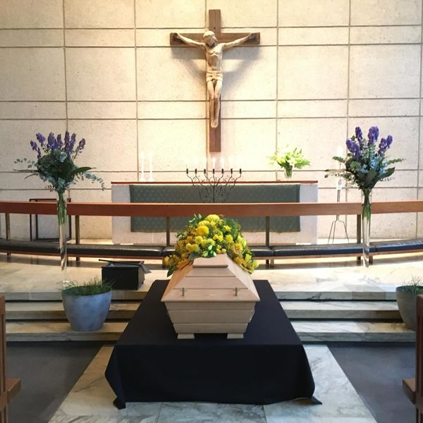 Funeral arrangment for coffin made of yellow flowers