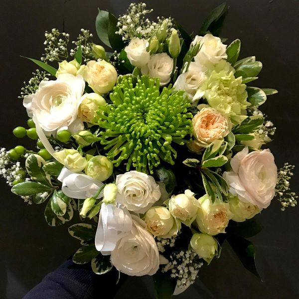 Lightcolored round funeralbouquet