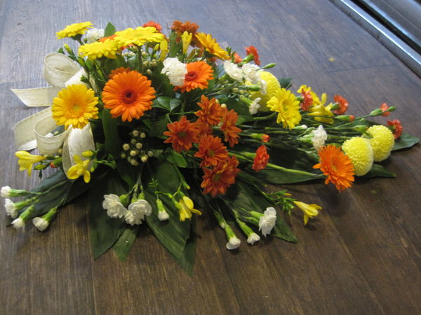 Yellow and orange funeralarragement